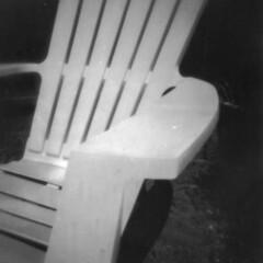 Rainy Day Pinhole -- 04 (Jack Ishlandt) Tags: rain rainy pinhole paper caffenol contact print chair plastic resin low light seat strange