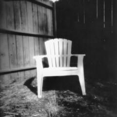 Rainy Day Pinhole -- 03 (Jack Ishlandt) Tags: rain rainy pinhole paper caffenol contact print chair plastic resin low light seat strange