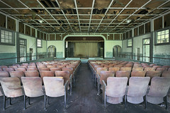 ...school spirit... (Art in Entropy) Tags: abandoned school auditorium architecture chair stage show curtain spirit urbex urban explore exploration decay derelict lost grime creepy light sony sonyalpha adventure photography photo art entropy ruin