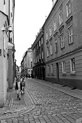 Poznań (Peter Gutierrez) Tags: photo europe european east eastern poland pole poles polish poznań posen renaissance old city town center centre quarter people street streets medieval hanseatic peter gutierrez petergutierrez building buildings cobble cobbles cobbled stone stones cobblestone cobblestones sidewalk pavement public film photograph photography