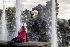 Girl at the fountain (Lyutik966) Tags: people child fountain water horse sculpture clothes jacket bow city street park moscow russia saariysqualitypictures