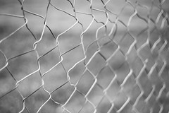 Waveform Collapse (Jeremy Beckman) Tags: blackandwhite hemet fence chainlink damage deformed bent pattern mesh obsession metal rust barrier detail abstract texture