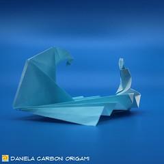 """""""Seduta al mare"""" Modello creato il 07/08/2019. Carta da origami, lato 25 cm.  A me piace più su sfondo azzurro. ❤ ------------------------------------------- """"Sitting by the sea""""  Model created on 07/08/2019. Kami, 25 cm edge. I like the most the on (Nocciola_) Tags: radicedidue sea papiroflexia paperfolding originaldesign danielacarboniorigami paper sedutaalmare origami mare silverrectangle onda paperart cartapiegata createdandfolded rettangolodargento wave squarerootoftwo sittingbythesea"""