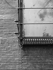 Chain (Nick Condon) Tags: abstract architecture blackandwhite brick chain chicago door metal olympus45mm olympusem10 paint wall