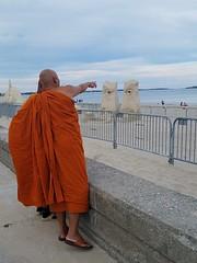 8-11-2019:  Monks marvel at still-standing sand sculptures. Revere, MA