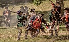 Hand To Hand (Wes Iversen) Tags: american brighton british colonialkensington kensingtonmetropark michigan milford nikkor18300mm colonial costumes guns men muskets people reenactments reenactors swords weapons