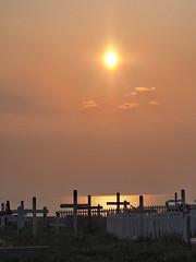 Tuktoyaktuk -  evening sun (oneofmanybills) Tags: tuktoyaktuk arctic sunset evening graveyard crosses crucifixes ocean sea seaside canada northwestterritories olympus skyline horizon