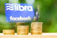 Libra coin blockchain concept / New project libra a cryptocurrency launched by Facebook and businessman on coin staircase mainstream digital currency through apps (poringdown) Tags: background banking bitcoin blockchain business button buy cash coin commerce crypto cryptocurrency currency digital economy editorial electronic exchange facebook finance financial global icon information internet libra like logo market marketing media mining money network networking online paper payment service sign social symbol technology trade virtual wallet web website white world