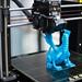 3D printer printing a dragon figure