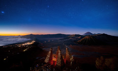 Star and Bromo mountain between night and sunrise time (anekphoto) Tags: horse hight tourism travel holiday outdoor blue surabaya java park astrophotography milkyway sunrise morning journey volcano star night destination mountain valcano pagoda viewicon view point seruni landscape nature sky beautiful fog adventure mount indonesia asia bromo national universe science background light way shine astronomy galaxy dark starry milky space nebula