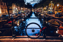 Spares (The Rolling Spoke) Tags: bike bicycle bici bicicleta bisiklet bicycles fiets velo street streetphotography canal night gracht grachtengordel amsterdam spare wheel water reflection
