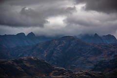 The Cuillin Mountains (stefanblombergphotography.com) Tags: awe awsome clouds dramatic hill hillside landscape light mighty mountainrange mountaintop mountains nature outdoor rock rocky sky stefanblombergphotography stone wild wwwstefanblombergphotographycom