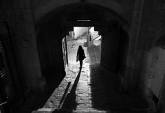 (cherco) Tags: woman france rocamadour arch arquitectura architecture silhouette lonely alone night city medieval down light shadow canon monochrome walk