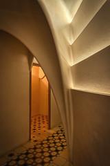 A Gaudí Corridor (henriksundholm.com) Tags: interior vignette corridor hall hallway narrow opening floor tiles pattern architecture building antonigaudi gaudi casamila lapedrera barcelona spain espana catalonia hdr