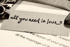 All You Need Is Love (amarilloladi) Tags: macro macromondays print invitations wedding printedword love allyouneedislove ribbon stamped words weddinginvitations marriage monochrome sepia