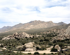 Journey Beyond (Scott Holcomb) Tags: wanderlust granitemountains mojavenationalpreserve california asahipentax6x7 supermulticoatedtakumar6x714575mmlens zenzabronica82mml1afilter kodakportra160film 6x7 mediumformat 220film epsonperfectionv600 photoshopdigitalization