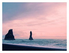 Reynisdrangar (Caleb Bertolini) Tags: iceland olympus sky blue white water ocean rocks rock landscape nature natural scenery golden circle cloud clouds cold mountain mountains winter horizon black sand outside pink