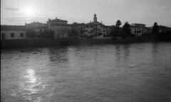 Lungadige (Paolo Levi) Tags: adige lungadige river verona water reflection sunset sun italy canon ae1program fd fdn 28mm hp5plus foma