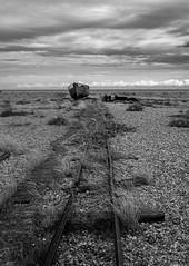 The End of the Line (daveseargeant) Tags: dungeness seaside coast sea water beach boat railway line pebbles seascape landscape scene monochrome black white blackwhite nikon df 50mm 18g