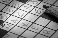 109 Across (kwphotos.com) Tags: macromondays printedword crossword puzzle clues letters pencil graphite ink newsprint paper blocks squares pattern texture black white bw blackandwhite monochrome