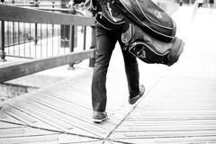 golf walk (santana.nuno.m) Tags: streetphotography stranger people person golf bridge highkey blackandwhite bw