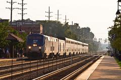 California Zephyr Eastbound (tim_1522) Tags: railroad railfanning rail illinois il bnsf burlingtonnorthernsantafe bn burlingtonnorthern chicago sub subdivision racetrack amtrak passenger superliner generalelectric p42dc orange sun glint