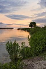 Sunset At Mackinac Island (DJ Wolfman) Tags: michigan michiganfavorites sunset water lake huron lakehuron yellow orange blue green mackinacisland missionpoint rocks sky olympus olympusomd em1markii micro43 zuiko