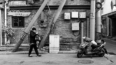 1996 (Go-tea 郭天) Tags: old history ancient alley traditional beijing hutong tradition narrow pékin républiquepopulairedechine street city winter light shadow portrait people urban blackandwhite bw woman sun white black cold building monochrome look lines electric bag walking asian outside blackwhite construction asia alone looking natural outdoor pavement walk candid bricks 1996 naturallight sunny historic motorbike cables purse electricity motorcycle historical lonely poles bnw cabinets china canon eos prime chinese 24mm 100d lady