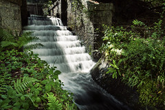 Secluded Cascade (Christian Hacker) Tags: trenchfordreservoir cascade waterfall longexposure secluded hidden tributary waterflow rushing stream brickwork fern dartmoor nationalpark uk devon nature cokinfilter nd8 canoneos50d tamron1750mm outandabout watermovement