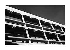 house of the sharp teeth (Armin Fuchs) Tags: arminfuchs lavillelaplusdangereuse würzburg house building diagonal light shadows net niftyfifty