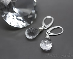 Elsa - Rock Crystal Clear Quartz earrings wire wrapped in sterling silver. Jewelry design by Arctida. (Arctida) Tags: rock crystal clear quartz faceted gemstone earrings sterling silver jewelry jewellery cocktail statement single engagement large heavy big drop briolette textured wiccan pagan elvish fairy party bohemian hippie boho chic wedding bride bridal simple accessory accessories neutral modern fall autumn summer spring winter trend time artisan designer europe handmade handcrafted scandinavian sweden new age magic fantasy organic fashion shopping outfit tip collection minimalistic delicate classic elegant girl women dark background solitaire spiritual gift idea macro