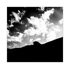 Only for Holidays (Thomas Listl) Tags: thomaslistl blackandwhite biancoenegro noiretblanc monochrome square barn house solitude sky dark clouds contrasts highcontrast hill shape light sunlight sunrays graphical heavy swiss schweiz graubünden