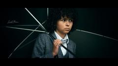 Umbrella boy (Lorrainemorris) Tags: moviestill child boy lorrainemorris streetphotography zeiss zeissbatis85 sony sony7rm2 cinematic