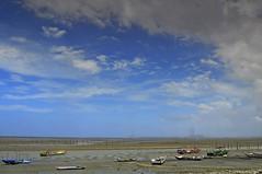 Boats at low tide (mattlaiphotos) Tags: clouds sky beach ocean boat lowtide seascape landscape scenery