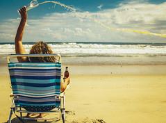 Warm Beer Sucks (Creekside Photog) Tags: beach summer beer ocean grain sand chair polkadots footprints