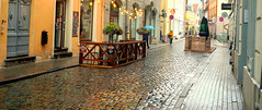 Riga in the Rain (mandalaybus) Tags: riga latvia street streets streetscape streetscapes building buildings ledifice lesedifices cobblestone he effect wet surface gives photo it comes alive fine candid david 5photosaday