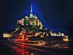 Mont St. Michel at Dusk (Trey Ratcliff) Tags: france montsaintmichel stuckincustomscom treyratcliff church cathedral monastery island spire hdr aurorahdr night village