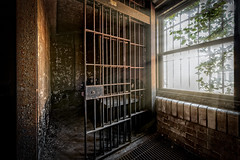 Women's Holding Cell (Frank C. Grace (Trig Photography)) Tags: fallriver massachusetts unitedstatesofamerica newengland abandoned urbex urbanexploration jail bedfordstreet bedfordstreetjail historic history prison policestation bedfordstreetstation contaminated old forgotten redevelopment frpd highstreet recordsdepartment court crime criminal nikon d850 trigphotography frankcgrace on1pics decay rusty rust jailcell cell confinement 1916 hdr highdynamicrange photography