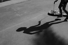 shadow game (Isidre Cor) Tags: fuji x100 bn monochrome street photography barcelona blanco y negro fotografia callejera people gente