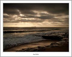 Dark Skies Over Farne Islands (flatfoot471) Tags: 2008 normal england unitedkingdom holiday northumberland august bamburgh beach coast northsea farneislands lighthouse summer