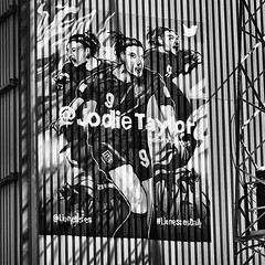 Lioness (see it, shoot it) Tags: trfc tranmererovers football art mural lionesses jodietaylor lionessesdaily leicam9 voigtlander 40mm12asph silverefex shadows lines contrast mono bw bytoriajaymes prentonpark ccd streetart square captureone12