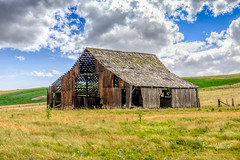 Needs One Strong Wind (rickwil64) Tags: barn abandoned clouds derelict farm