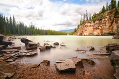 Athabasca Falls (Kirby Wright) Tags: athabasca falls river long exposure rocks shore beach pebbles cliffs cliff forest pine mountains jasper national park canada vacation nikon d750 1735mm f28 neutral density filter manfrotto tripod
