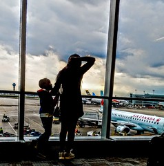 A Tender Moment (WTW Pics) Tags: mommy son young parent airport aircanada yyz airplane aircraft family googlepixel2 toronto sunset