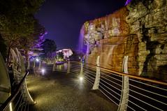 A Purple Waterfall (henriksundholm.com) Tags: landscape hdr city urban night water waterfall bridge wall shadows sentosa singapore southeast asia lamps lights trees railing path bend corner