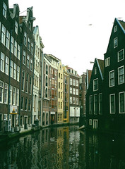 View of Canal in Amsterdam, Netherlands (alexdavidwriter) Tags: amsterdam netherlands holland canal water oudezijdsachterburgwal architecture dutch buildings houses windows view denwallen