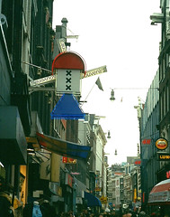 View of Kalverstraat Store Signs, Amsterdam, 2003 (alexdavidwriter) Tags: amsterdam kalverstraat holland netherlands shopping dutch windmill sign tourist souvenir commercial symbols