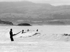 Surfers at Criccieth Beach (RedPlanetClaire) Tags: wales summer criccieth surfer beach bay sea
