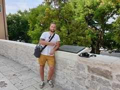 Pointing down at the UNESCO sign stating that Sibenik Cathedral has the status.