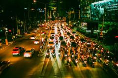 Bangkok at night on film (Thanathip Moolvong) Tags: olympus om2 28mm f28 fuji c200 negative film bangkok night street traffic